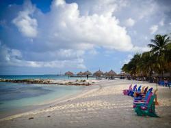 Adirondack chairs near Divi Phoenix Aruba