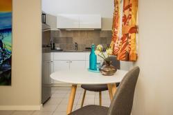 Paradera Park Deluxe Studio - Dining Table Kitchen.jpg
